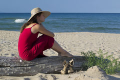 Woman relaxing on the beach Stock Image