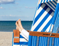 Woman relaxing on beach Royalty Free Stock Photos