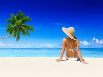 Woman Relaxing on the Beach Royalty Free Stock Images