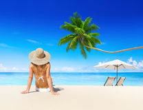 Woman Relaxing on the Beach Royalty Free Stock Photography
