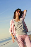 Woman relaxing on the beach Royalty Free Stock Photo