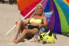 Woman relaxing on the beach Royalty Free Stock Photos