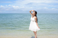 Woman relaxing at the beach. Asian woman relaxing at the beach Stock Photos