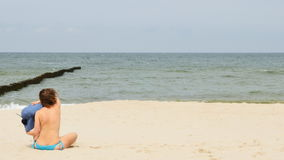 Woman relaxing on the beach stock footage