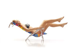Woman relaxing in beach chair Stock Images