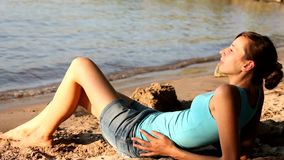 Woman relaxing on beach stock footage