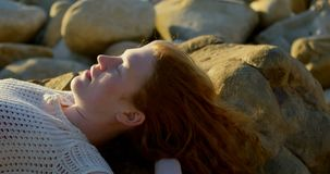 Woman relaxing on the beach at dusk 4k. Young woman relaxing on the beach at dusk 4k stock video