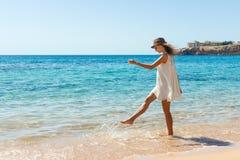 Woman relaxing at beach enjoying summer freedom. Happ girl at the beach.  Stock Photo