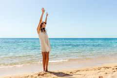 Woman relaxing at beach enjoying summer freedom. Happ girl at the beach.  Royalty Free Stock Images