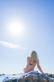 Woman relaxing on the beach in Greece Stock Photography