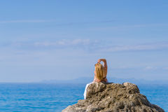 Woman relaxing on the beach in Greece Royalty Free Stock Photos