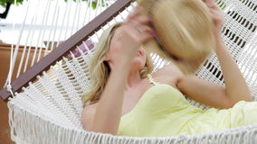Woman Relaxing In Beach Hammock Stock Photo