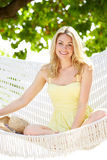 Woman Relaxing In Beach Hammock. Smiling To Camera Royalty Free Stock Photography