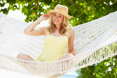 Woman Relaxing In Beach Hammock. Smiling To Camera Royalty Free Stock Image