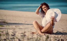 Woman relaxing on the beach near the sea Royalty Free Stock Images