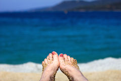 Woman relaxing on beach by the sea. Royalty Free Stock Photo