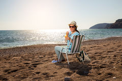 Woman relaxing on the beach Royalty Free Stock Image