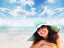 Woman relaxing on the beach. stock photography