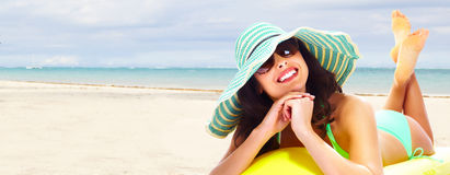Woman relaxing on the beach. stock images