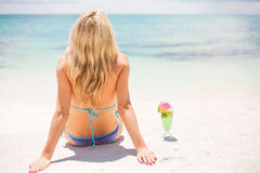 Woman relaxing on the beach Stock Images