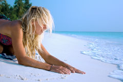 Woman relaxing on a beautiful beach Royalty Free Stock Photo