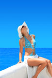 Woman relaxing on beautiful shoreline Stock Photography