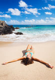 Woman relaxing on beautiful tropical beach Stock Image