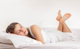Woman Relaxing. Beautiful young woman relaxing in the bed Royalty Free Stock Photos
