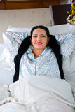 Woman relaxing in bed Royalty Free Stock Photo