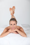 Woman relaxing on a bed Royalty Free Stock Photography