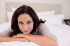 Woman relaxing on the bed Royalty Free Stock Photos