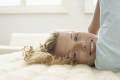 Woman Relaxing On Bed Royalty Free Stock Photography