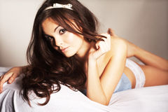 Woman Relaxing in Bed Royalty Free Stock Images