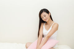 Woman relaxing in bed Stock Photo