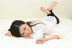 Woman relaxing in bed Royalty Free Stock Photos