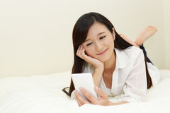 Woman relaxing in bed Stock Image