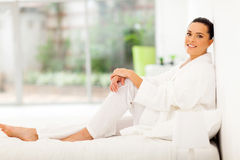 Woman relaxing bed Stock Photos