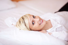 Woman Relaxing On Bed At Home Royalty Free Stock Photos