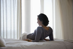 Woman Relaxing On Bed Stock Image