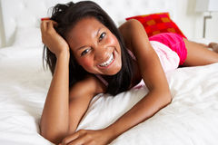 Woman Relaxing In Bed Wearing Pajamas Royalty Free Stock Photography