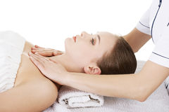 Woman relaxing beeing massaged in spa saloon Royalty Free Stock Photos
