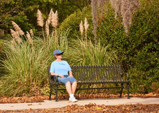 Woman Relaxing ON Bench Stock Image