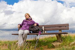 Woman relaxing on a bench Stock Image