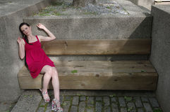 Woman Relaxing on Bench Stock Photos