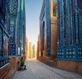 Woman relaxing on the bench. And enjoying beauty of the ancient complex of Shah-i-Zinda, Samarkand, Uzbekistan Stock Images