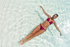 Woman relaxing in blue lagoon Stock Photography