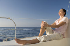 A woman relaxing on a boat Stock Image