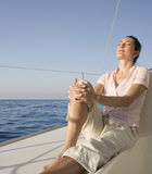 A woman relaxing on a boat Royalty Free Stock Photo