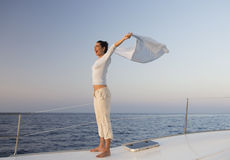 A woman relaxing on a boat Royalty Free Stock Image