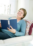 Woman relaxing with book at home Royalty Free Stock Photo